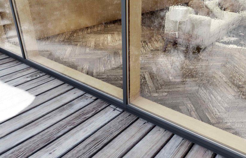 Vista esterna di una facciata continua con rivestimento in alluminio bronzo anticato