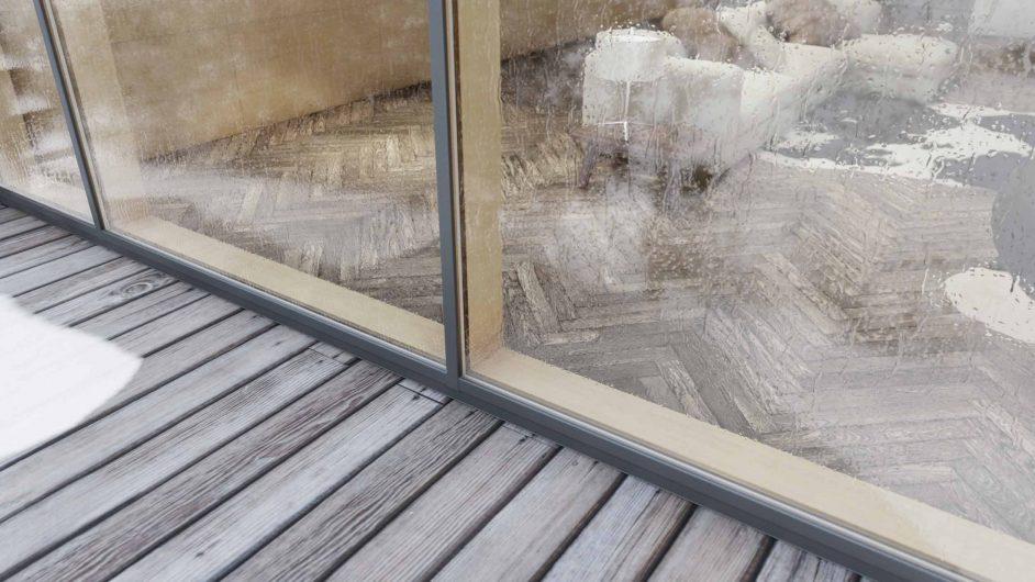 Dettaglio del profilo in legno di una facciata continua rivestita in alluminio effetto bronzo