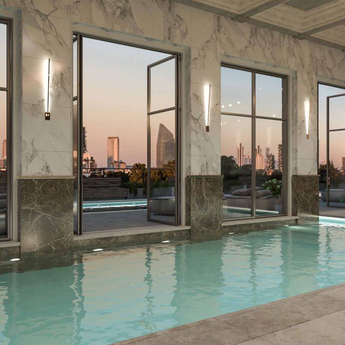 Vista di una piscina coperta con serramenti a bilico a due ante Skyline Metal