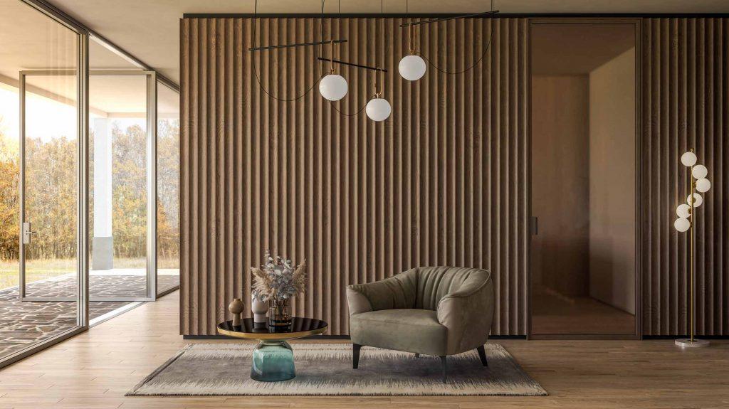 Vista della boiserie in legno e della porta interna con telaio minimale in metallo